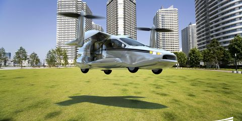 Airplane, Daytime, Tower block, Aircraft, Automotive tire, Plain, Building, Aerospace engineering, Condominium, Metropolitan area,