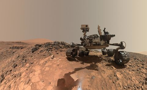 """This low-angle self-portrait of NASA's Curiosity Mars rover shows the vehicle at the site from which it reached down to drill into a rock target called """"Buckskin."""" The MAHLI camera on Curiosity's robotic arm took multiple images on Aug. 5, 2015, that were stitched together into this selfie."""