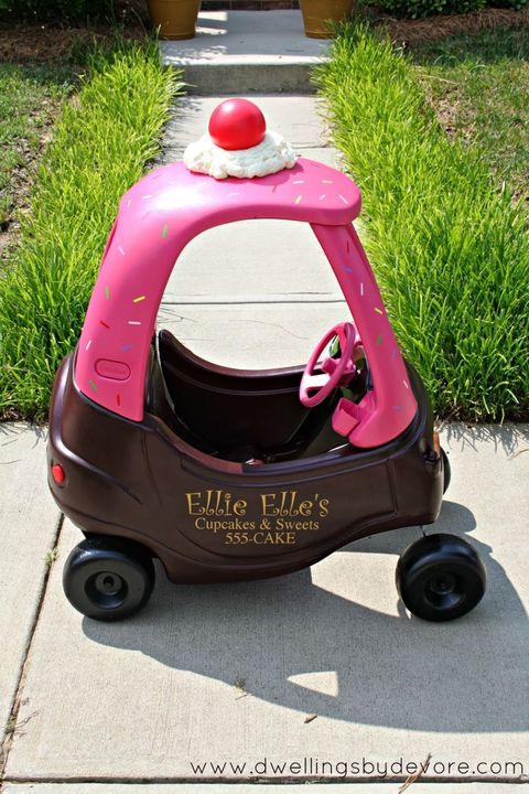 """<p>The cherry on top of this cupcake car makeover is <em>literally </em>a cherry on top. The toy even features adorable bakery signage on the side in case you want to send your little one around to neighbors with treats.</p><p><a href=""""http://www.dwellingsbydevore.com/2013/06/cozy-coupe-makeover.html#.VtcxwZPF_iS"""" target=""""_blank""""><em>See more at Dwellings By Devore »</em></a></p>"""