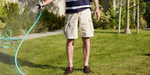 Joint, Human leg, Shorts, board short, Active shorts, Bermuda shorts, Trunks, Lawn, Calf, Garden hose,