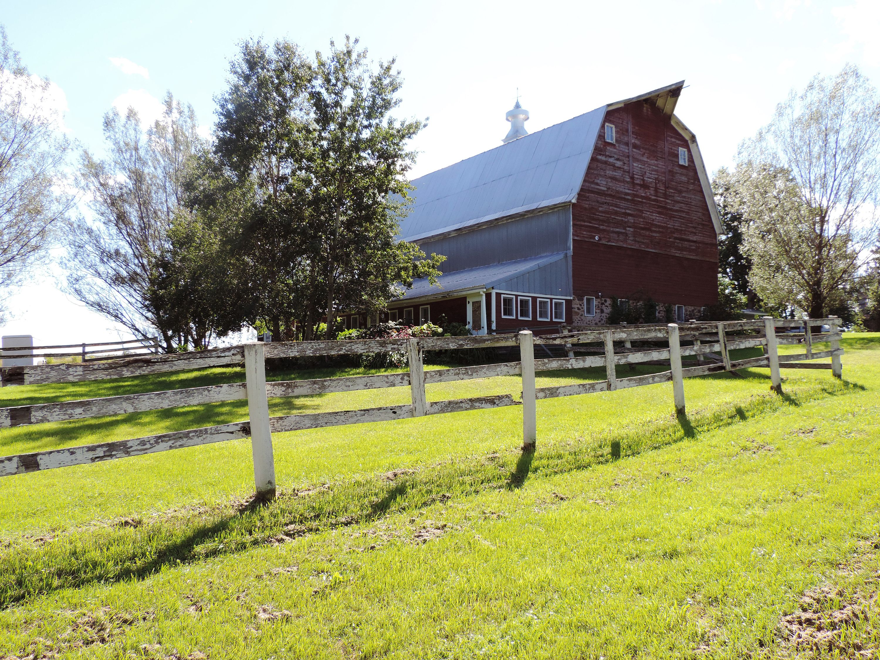 """<p>There's a silo attached to this ca. 1921 barn, which features a prominent widow's peak and sits on 30 partially-wooded acres. The stately structure could be the ultimate live/work space—it was previously used as a gift shop.</p><p><strong>Asking Price:</strong> $114,900</p><p>For more information, contact Kyle Pierce, (715) 416-2900 or visit <a href=""""http://www.nwlandandrec.com/"""">Northwest Land & Recreation</a>.</p>"""
