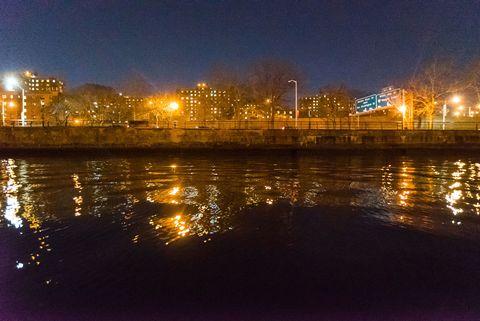 Night, Reflection, Water resources, Liquid, Street light, City, Metropolitan area, Amber, Light, Electricity,