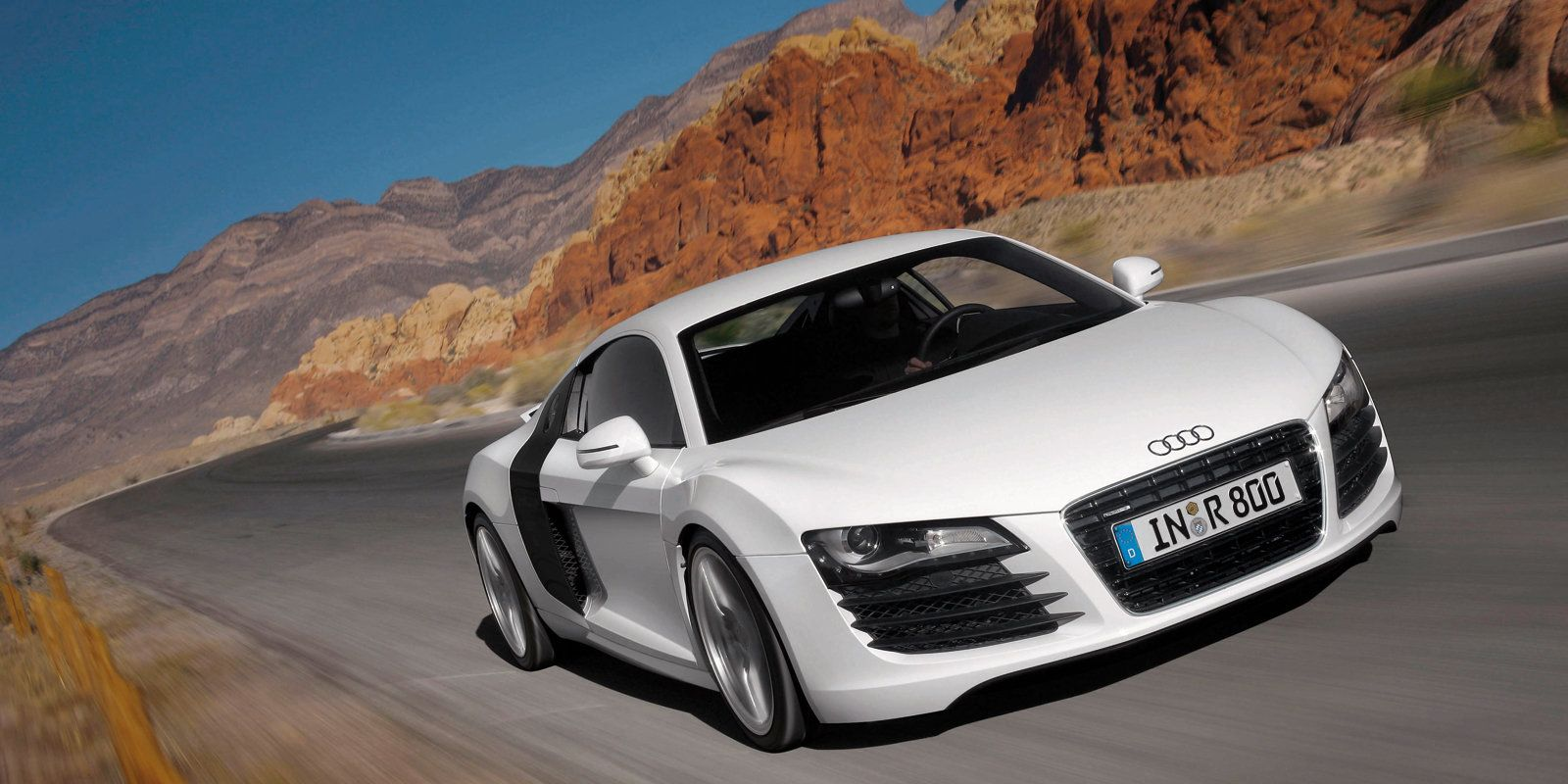 """<p>You can credit the LED running lights and the modern Audi grille with some of Audi's success in recent years, but without the R8, we can't imagine any of that would have been nearly as effective. <a href=""""http://www.roadandtrack.com/new-cars/road-tests/reviews/a13450/2008-audi-r8/"""" target=""""_blank"""">The R8 proved Audi</a> could build a real supercar and got people to pay attention to the company.</p>"""