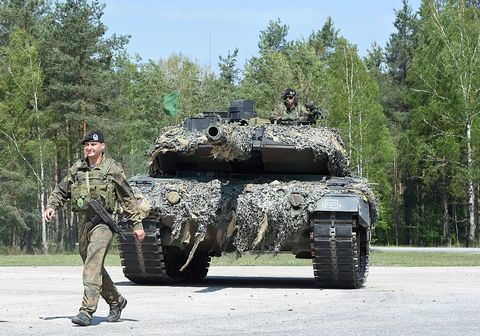 Soldier, Army, Military person, Military camouflage, Combat vehicle, Military uniform, Military vehicle, Camouflage, Military organization, Tank,