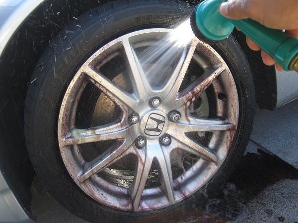 <p>Look for a cleaner specifically made for your wheel material. Chrome takes a harsher cleaner than anodized aluminum, and clear-coated wheels need a product that won't damage that coating. Buy a long-handled brush for extra leverage, since cleaning brake dust is a job and a half. Use a smaller lug brush to get the tight space around lug nuts. Clean and dry one wheel at a time, and then apply Wheel Wax. Polish it off when it hazes over. You only have to use Wheel Wax twice a year, so skip it otherwise.