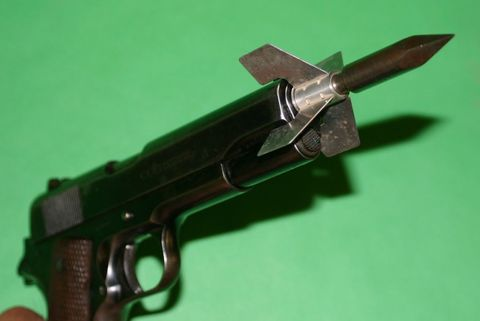 Gun, Firearm, Trigger, Tan, Gun accessory, Gun barrel, Metal, Air gun, Steel, Still life photography,