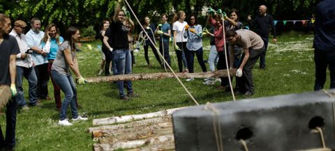 College kids moving one-ton stones like they might have done in Stonehenge.