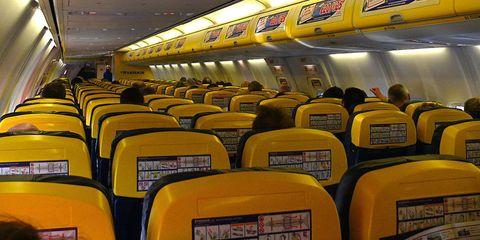 Mode of transport, Transport, Yellow, Air travel, Comfort, Public transport, Amber, Ceiling, Service, Light,