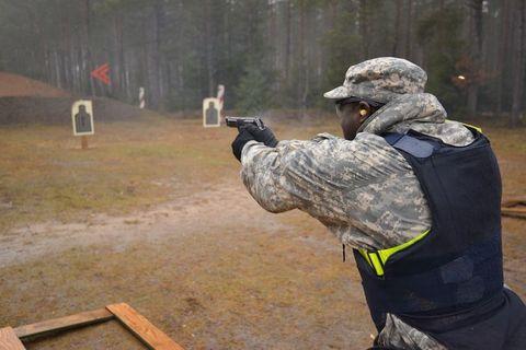 Shooting, Gun, Military person, Firearm, Paintball equipment, Combat pistol shooting, Soil, Shooting sport, Shooting range, Soldier,