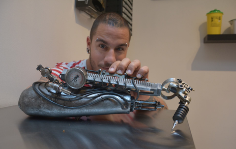Tattoo Artist Loses Arm, Builds Tattoo-Drawing Prosthetic