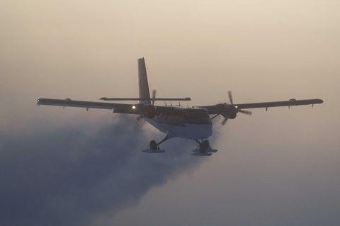 Airplane, Sky, Aircraft, Atmosphere, Air travel, Aerospace engineering, Aviation, Atmospheric phenomenon, Propeller-driven aircraft, Flight,
