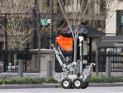 Sidewalk, Machine, Military robot, Curb, Tar, Rolling, Driveway,