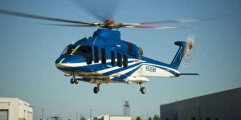 Helicopter, Rotorcraft, Mode of transport, Blue, Aircraft, Transport, Natural environment, Infrastructure, Helicopter rotor, Photograph,
