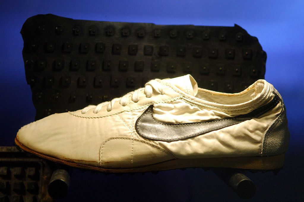 Nike 'Moon Shoe' worn by Mark Covert in the 1972 U.S. Olympic Trials. The  shoes were made in a waffle iron and were the first Nike shoes worn during  ...