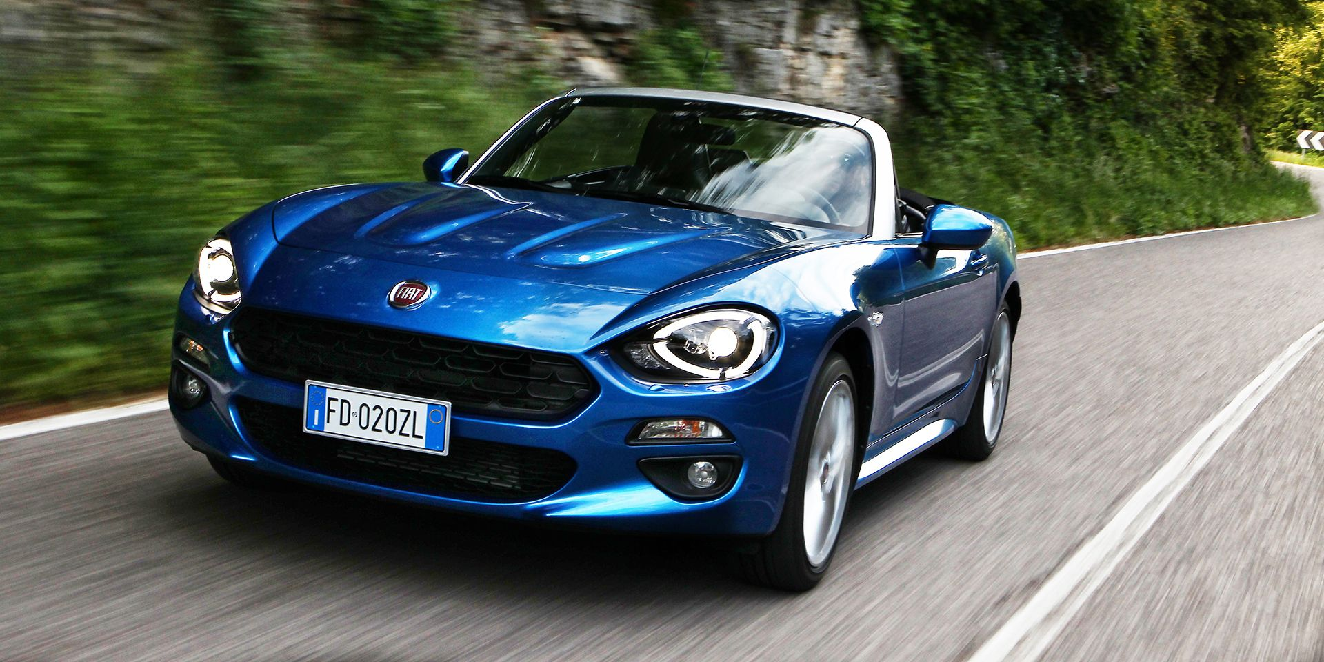"""<p><a href=""""http://www.roadandtrack.com/new-cars/first-drives/news/a29486/fiat-124-qa-review/"""" target=""""_blank"""">The Fiat 124 Spider</a>'s $24,995 starting price puts it about as close to our $25,000 cutoff as you can get, but hey, it still counts. And while it's heavier and <a href=""""http://www.caranddriver.com/fiat/124-spider"""" target=""""_blank"""">not quite as quick as the Miata</a> it's based on, that added weight goes towards making the 124 Spider more comfortable and refined. </p>"""