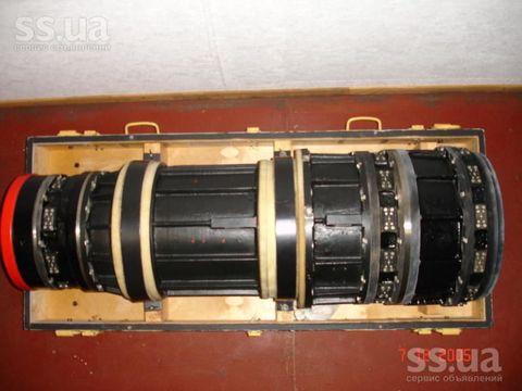 Lens, Amber, Cameras & optics, Machine, Metal, Camera lens, Camera accessory, Still life photography, Paint, Cylinder,