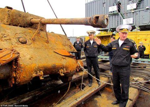 Workwear, Engineering, Employment, Job, Combat vehicle, Blue-collar worker, Self-propelled artillery, Service, Engineer, Pipe,