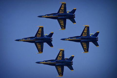 Airplane, Aircraft, Blue, Mode of transport, Yellow, Transport, Aviation, Air travel, Fighter aircraft, Jet aircraft,