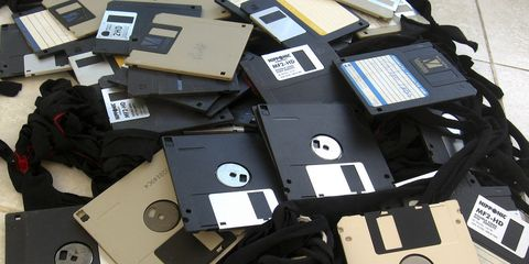 Technology, Laptop accessory, Floppy disk, Laptop part, Blank media, Everyday carry, Electronics accessory, Office equipment, Plastic, Data storage device,