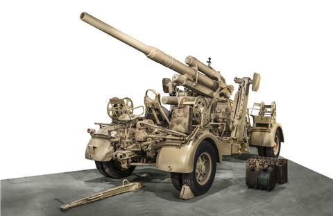 Military vehicle, Machine, Engineering, Tread, Cannon, Combat vehicle, Gun turret, Self-propelled artillery, Synthetic rubber, Construction equipment,