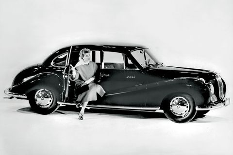 """<p>Having found itself on the wrong side of the war, the Werke took a while to rebuild. And in 1951, when the swoopy, sophisticated 501 rolled out, BMW announced to the world that it was back in grand style. The general public called it the """"<em>Barockengel,</em>"""" or the Ba-roque Angel, a thoroughly dramatic nickname as only the Germans can do. The 501 became the first German car to be built with a V8, and later the first car in the world with an aluminum V8: capable of 140 horsepower and over 100 miles per hour, it was a postwar return in the finest of forms.</p>"""