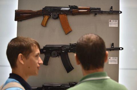 Gun, Firearm, Trigger, Shooting, Machine gun, Gun accessory, Gun barrel, Tan, Air gun, Shotgun,