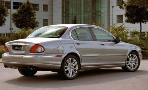 """<p>The transverse-engine, front-drive Mondeo architecture seemed unlikely for Jaguar duty, but it was fluffed up with standard all-wheel drive, and the Ford Duratec V-6 engines got new heads. The exterior aped the bigger Jags with a miniature rendition of their chrome grille and four round headlights. The plasticky interior received a swath of wood veneer and a helping of leather. Sales in its first year, 2002, totaled a healthy 33,018 (more than twice what the brand sold here in 2014), but it didn't last. Derided as a rebodied Ford and therefore Not a Real Jaguar, X-type sales quickly fell off. Ambitious pricing didn't help (C/D's <a href=""""http://www.caranddriver.com/reviews/2002-jaguar-x-type-long-term-road-test"""" target=""""_blank"""">long-term 2002 X-type</a> stickered for $45,095—or nearly $60K today). <br><br>So profound was the embarrassment of the X-type that, after it was put down, its specter haunted the very idea of a smaller Jaguar. The new <a href=""""http://www.caranddriver.com/jaguar/xe/"""" target=""""_blank"""">Jaguar XE</a> is the first attempt at one since then, and it will be up to that car to finally drive a stake through the X-type's heart. <em data-redactor-tag=""""em"""">—Joe Lorio</em></p>"""