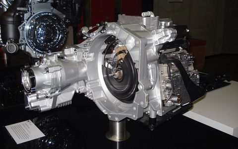 <p>Basically, advanced dual clutch transmissions (DCT) offer the benefits of a traditional automatic transmission with none of the drawbacks. On a six-speed DCT gearbox, for instance, one clutch shifts the odd gears (1, 3 and 5) and the other one handles even gears (2, 4 and 6). The twin clutches allow the driver to shift gears seamlessly with incredible speed. The result is something as easy to use as an automatic but with quicker shifts than a manual. </p><p><br></p><p>Dual clutch transmissions have been used in racing since the 1980s. Volkswagen was the first to popularize the transmission and democratize its use in relatively pedestrian cars. VW's dual clutch transmission, called DSG, was launched in mainstream performance vehicles like the GTI in 2003. The downside of dual-clutch? They put a big nail in the manual transmission's coffin. Today, these transmissions are used by just about every brand in performance applications, from Mercedes-Benz to Lamborghini.</p>