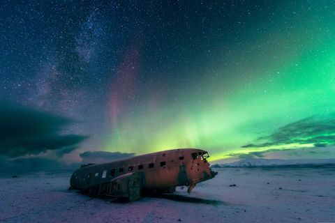 <p>In 1973, a U.S. Navy airplane—a Douglas Super DC-3 to be exact—crash landed on Sólheimasandur Beach in the south of Iceland. The entire crew survived, butthe plane was abandoned and left to rot. It's located not too far from the Skógafoss Waterfall, but youneed four wheel drive to navigate the unpaved roads if you want to see it.</p>