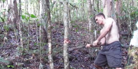 primitive tech chopping wood