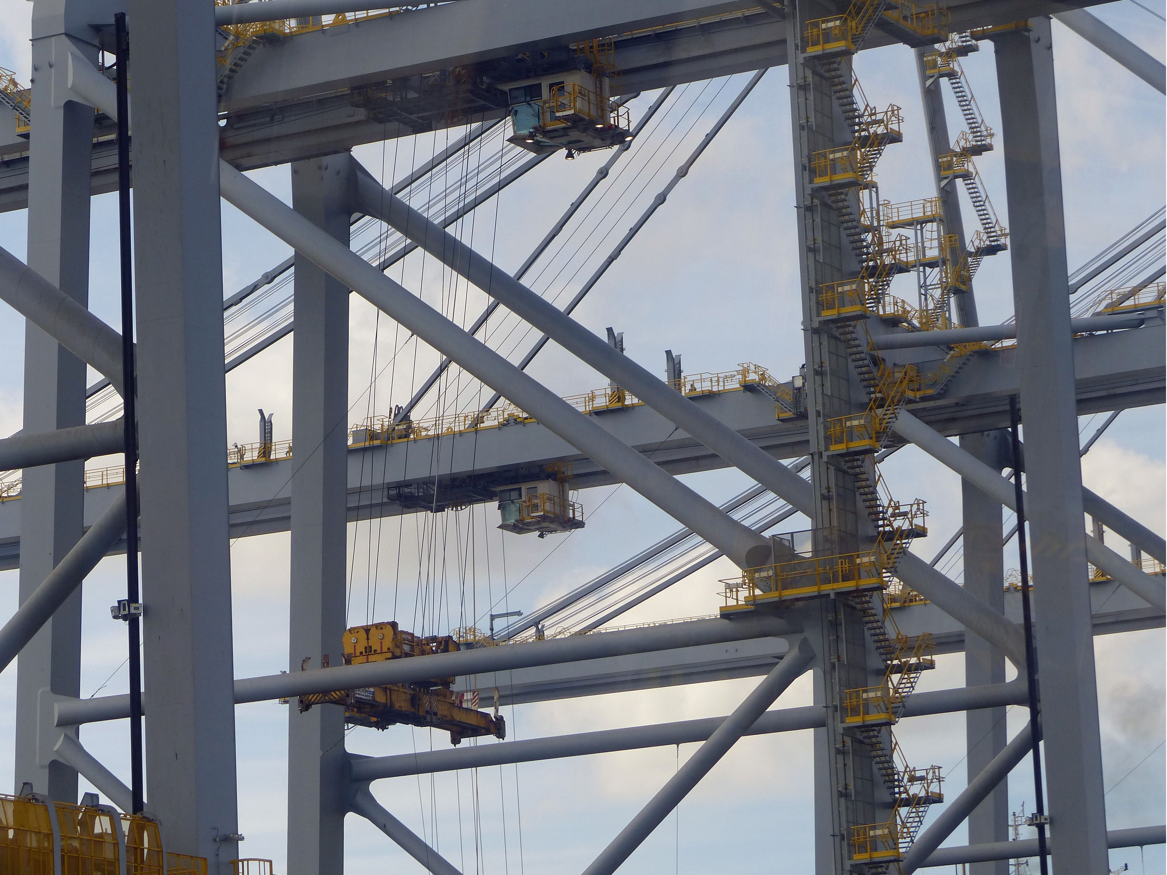 "<p>Containers are lifted off the ship two at a time&nbsp&#x3B;by quay cranes, 450-foot-high behemoths with booms long enough to reach across the width of the ship .</p><p><br></p><p>The cranes at London Gateway are the largest in the world&nbsp&#x3B;and were imported from China by the Zhen Hua, a special transport ship <a href=""http://onthethames.net/2016/07/01/huge-cranes-arrive-london-gateway/"">which carries assembled cranes in one gigantic&nbsp&#x3B;piece</a>. Each of the 2,000-ton cranes runs on rails supported by foundations driven 150 feet into the ground.&nbsp&#x3B;The operators sit in cabs high above.&nbsp&#x3B;</p><p><br></p><p>When unloading these ships, it's better to have good motor skills rather than brute strength.</p>"