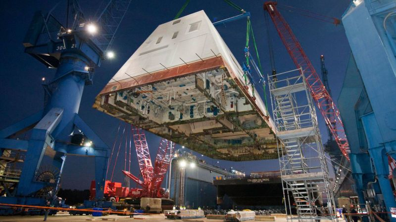 <p>The USS Zumwalt's 1,000-ton deckhouse is lifted and affixed to the ship's deck on December 14, 2012. Looks more like a spaceship than a naval ship. </p>
