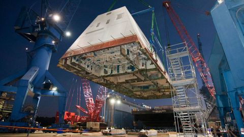 <p>The USS Zumwalt's 1,000-ton&nbsp;deckhouse is lifted and&nbsp;affixed to the ship's deck on December 14, 2012. Looks more like a spaceship than a naval ship.&nbsp;</p>