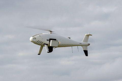 Airplane, Sky, Daytime, Aircraft, Cloud, Propeller, Flight, Atmosphere, Aircraft engine, Air travel,