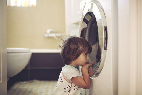 Boy in Front of Washing Machine