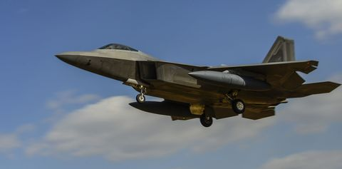 Airplane, Mode of transport, Sky, Aircraft, Daytime, Aviation, Military aircraft, Wing, Glass, Aerospace engineering,