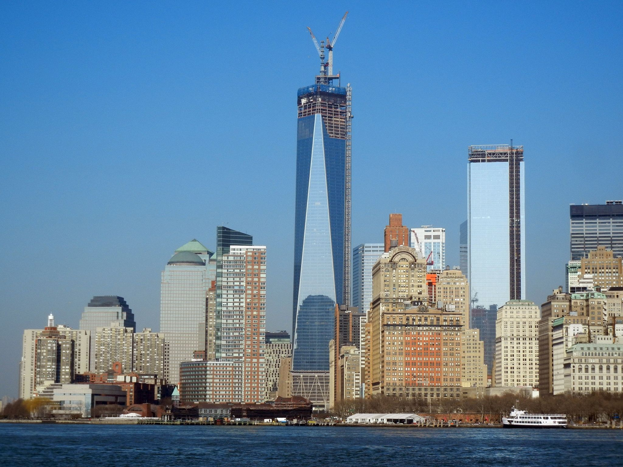 <p>The height of One World Trade Center has purpose. The tower, raised at the northwest corner of the 16-acre World Trade Center site, stretching upwards to 1,776 feet, representing the year of the United States Declaration of Independence. Completed in 2014—13 years after the devastation of Sept. 11, 2001—the Skidmore, Owings & Merrill-designed skyscraper reaches 104 stories tall with puts it in the world's top six tallest, counting the pinnacle spire. Without the spire, the building stands 1,368 feet tall. In honor of the original World Trade Center towers, the base of the new tower measures the same as the old towers at 200 feet square.</p>