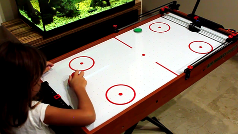 Indoor games and sports, Games, Air hockey, Play, Machine, Plywood, Learning, Recreation room,