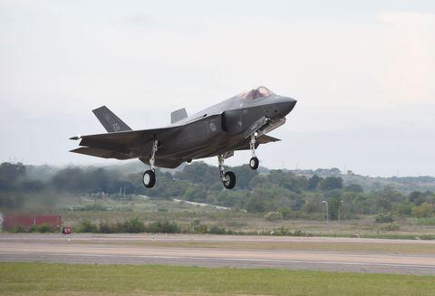 Airplane, Aircraft, Aviation, Plain, Military aircraft, Runway, Fighter aircraft, Automotive tire, Windshield, Aerospace manufacturer,