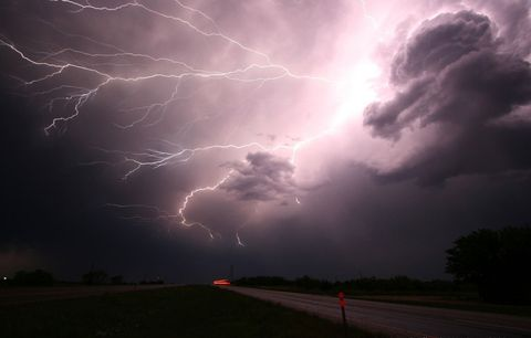Sky, Atmosphere, Thunderstorm, Storm, Atmospheric phenomenon, Infrastructure, Cloud, Road, Photograph, Thunder,
