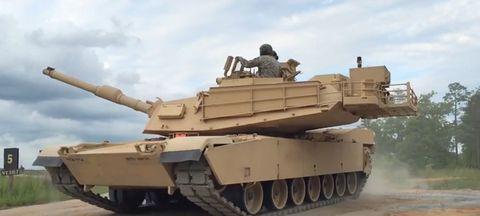 Mode of transport, Combat vehicle, Tank, People, Sky, Military vehicle, Self-propelled artillery, Tan, Khaki, Beige,