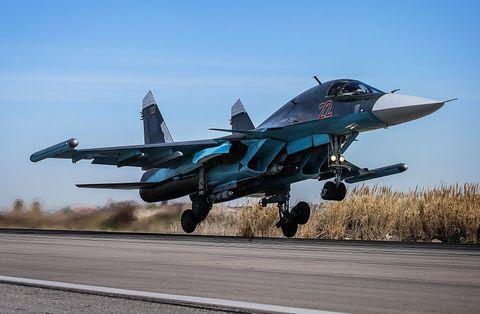 Airplane, Aircraft, Mode of transport, Blue, Sky, Fighter aircraft, Road, Military aircraft, Road surface, Jet aircraft,