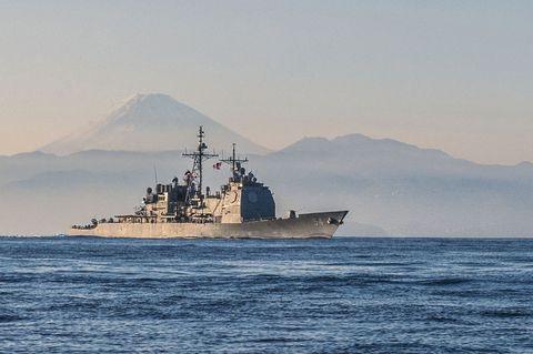 Watercraft, Water, Boat, Naval ship, Mountain range, Atmospheric phenomenon, Highland, Hill, Horizon, Warship,