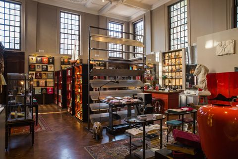 "<p>Assouline's <a href=""http://www.assouline.com/london-piccadilly"" target=""_blank"" data-tracking-id=""recirc-text-link"">London flagship</a> bills itself as a ""concept store for culture"" and the richly decorated bookshop certainly embodies that categorization. In addition to purchasing rare first editions and leather-bound volumes, visitors can sip on&nbsp;tea or cocktails in the Swan Bar&nbsp;or personalize their favorite works&nbsp;with bespoke bindery.</p><p><span class=""redactor-invisible-space"" data-verified=""redactor"" data-redactor-tag=""span"" data-redactor-class=""redactor-invisible-space""></span></p>"