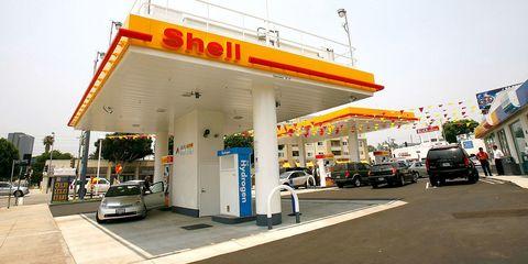 Filling station, Land vehicle, Automotive design, Automotive parking light, Gas pump, Automotive lighting, Gasoline, Fuel, Machine, Gas,