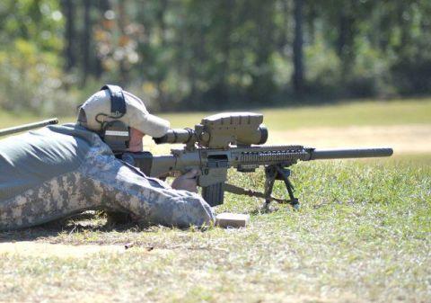 Shooting, Gun, Rifle, Firearm, Machine gun, Soldier, Gun barrel, Military camouflage, Trigger, Air gun,