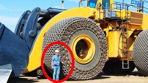 Automotive tire, Automotive design, Yellow, Fender, Automotive wheel system, Synthetic rubber, Tread, Auto part, Machine, Engineering,
