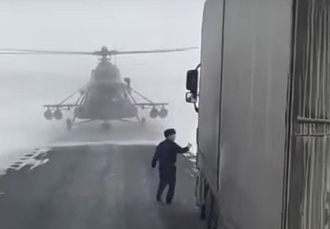 Helicopter Lands in the Middle of the Road to Ask for Directions