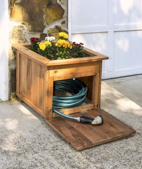 "<p>This DIY hose holder&nbsp&#x3B;completely camouflages all of that tubing and serves as a planter—you can get&nbsp&#x3B;the tutorial at <a href=""http://diycandy.com/2016/06/diy-pallet-wood-hose-holder-with-planter/"" target=""_blank"" data-tracking-id=""recirc-text-link"">DIY Candy</a>.<span class=""redactor-invisible-space"" data-verified=""redactor"" data-redactor-tag=""span"" data-redactor-class=""redactor-invisible-space""> (Carpentry not your thing? This <a href=""http://www.simplyorganized.me/2014/10/simple-diy-hose-holder.html"" target=""_blank"" data-tracking-id=""recirc-text-link"">DIY fencepost hose-holder</a> may be more your speed.)</span></p>"
