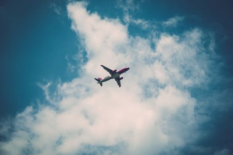 Airplane, Daytime, Sky, Aircraft, Flight, Cloud, Atmosphere, Air travel, Airline, Aviation,